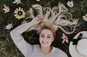 woman lying on flowers